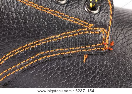 Shoe stiches on boot close up.
