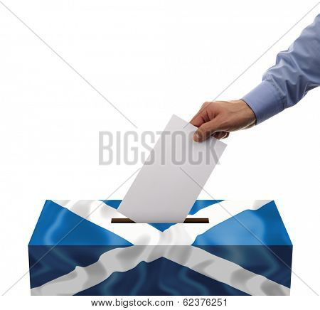 Scottish independence referendum ballot box covered in scotlands flag with person casting vote on blank voting slip