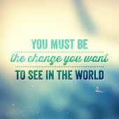 """Quote Typographical Poster, vector design. """"You must be the change you want to see in the world"""". Vintage Blurred Sky Background with Retro Texture  poster"""