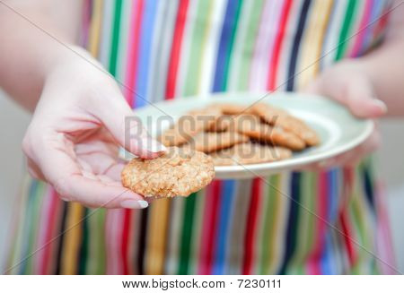 Woman Holding Out Cookies