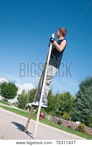Teenage Boy On Stilts