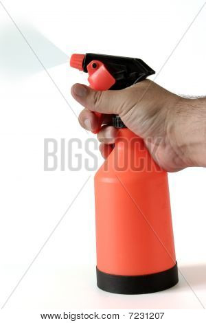 Hand with sprinkling sprayer
