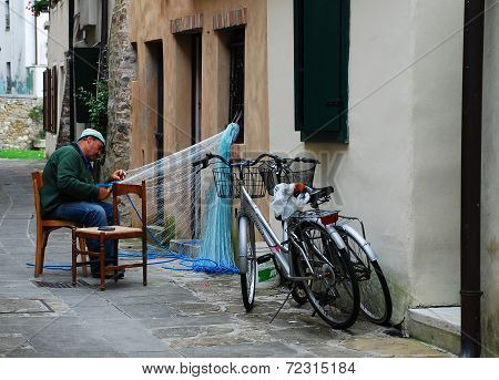 Fisherman Mending Net in Grado