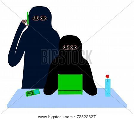 Two muslim women at a table with a cell phone and laptop