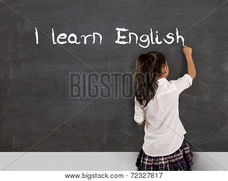 Schoolgirl Writing I Learn English With Chalk On Blackboard School