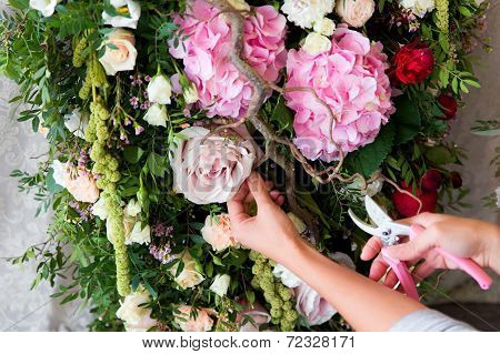 Florist At Work. Woman Making Spring Floral Decorations The Wedding Table , The Bride And Groom.