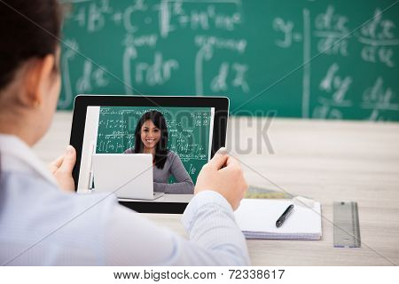 Woman Having Videochat With Digital Tablet