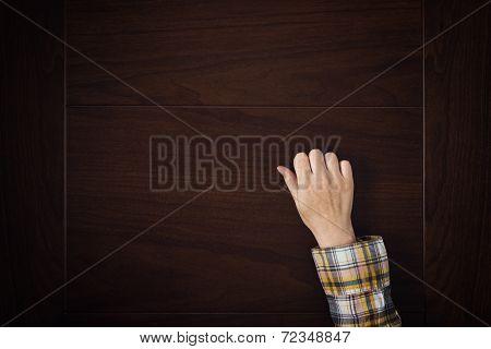 Hand Is Knocking On The Door