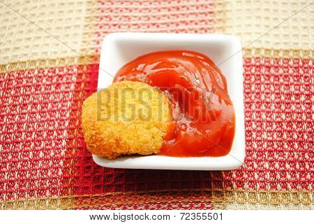 A Chicken Or Fish Baked Nugget In Catsup