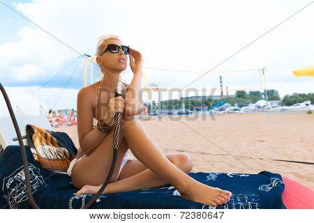 Woman With Hookah On Beach In Bikini