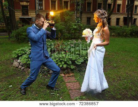 Wedding Photographer Taking Picture Bride, Camera Flash Flashing
