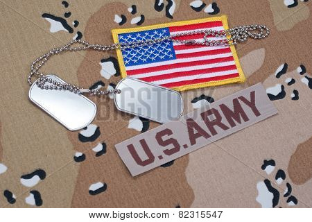 Us Army Concept With Dog Tags On Camouflage Uniform