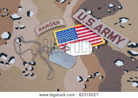 US ARMY ranger tab with blank dog tags on camouflage uniform poster