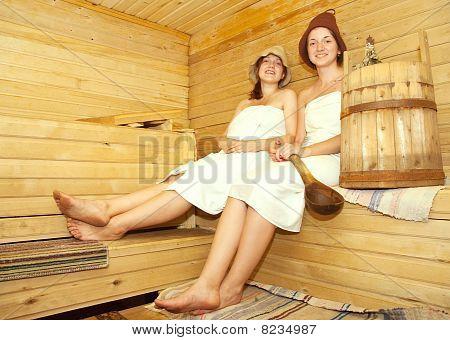 Girls On Bench In Sauna