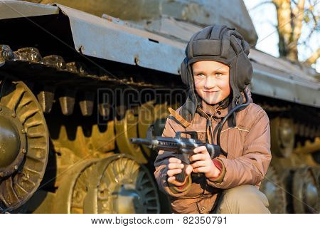 Portrait Of Young Boy With Gun