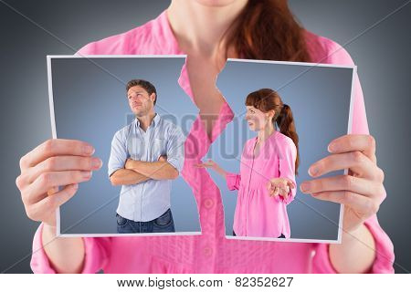 Woman arguing with uncaring man against grey vignette