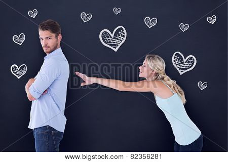 Desperate blonde reaching for boyfriend against blackboard