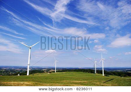 Wind energy farm and clear blue sky.