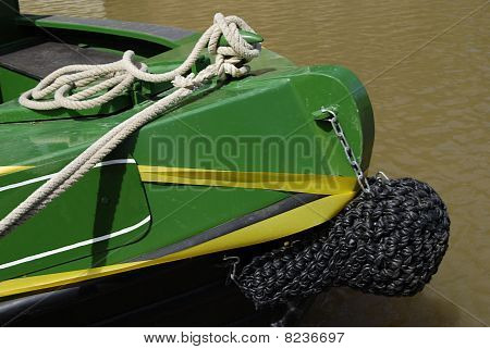 Bow of barge boat with knotted rope fender on the Wey and Arun canal at Loxwood. West Sussex. England poster