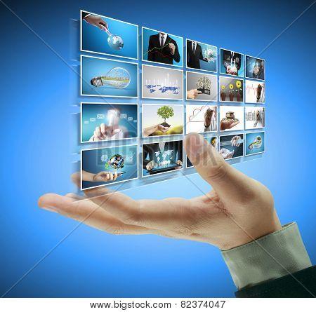 Businessman touch screen to choose digital photos