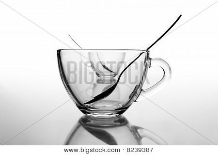 2 glass tea cups with reflection on white at 10Mps poster