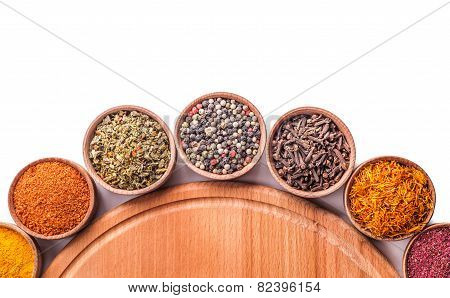 set spices in a wooden bowl on white background poster