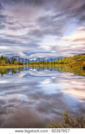 Cloudy dawn at Oxbow Bend on the Snake River in Wyoming poster