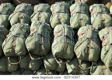 Paratrooper green parachutes piled up before take off