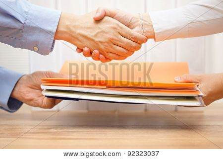 Entrepreneur Shaking Hands With His Accountant After Passing Documentation And Invoices