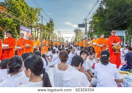 Many people give food and drink for alms to 1536 Buddhist monks in visakha bucha day