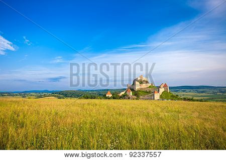 Old Medieval Fortress On Top Of The Hill, Rupea Village Located In Transylvania