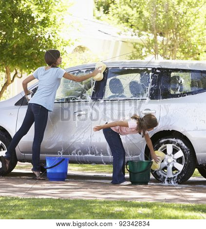 Two Girls Washing Car Together