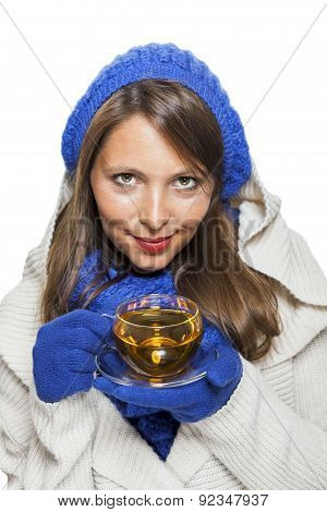 Fashionable Young Woman Sipping Hot Tea