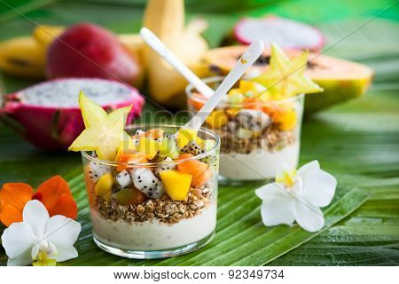 Healthy breakfast with exotic fruits, yogurt and granola