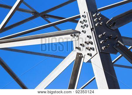 Steel Beams Against The Blue Sky. Fragment Metal Framework.