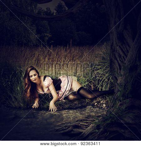 Beautiful Sexy Woman Lie  In Dark Forest