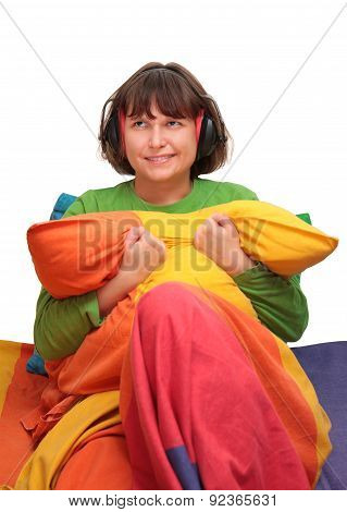 girl in bed with headphones on a white background