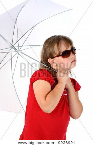 Portrait of little blonde girl under white umbrella with dark sunglasses isolated on white backgroun