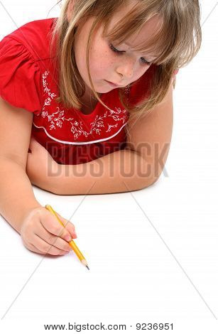 Small girl drawing something with a pencil isolated on white