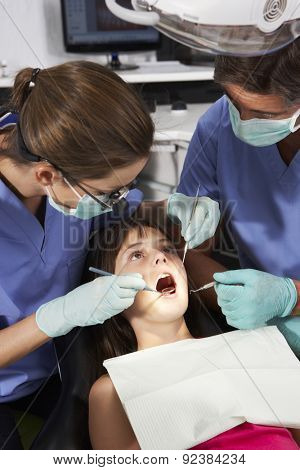 Dentist And Nurse Giving Girl Check Up