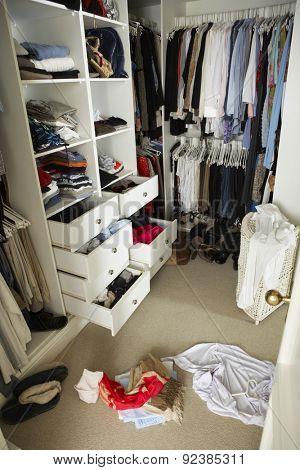 Untidy Teenage Bedroom With Messy Wardrobe
