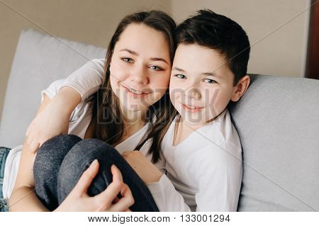 Sincere and warm embrace of brother and sister