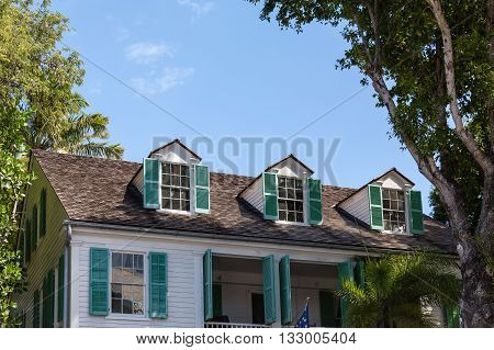 Green Shutters on Dormers of old house in Key West