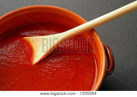 Terracotta Pot And Wooden Spoon With Tomato Sauce. Closeup 2