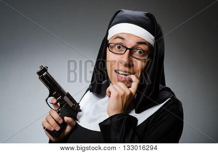 Man dressed as nun with handgun