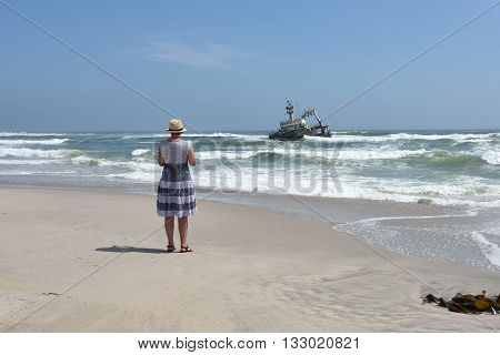 Woman On The Ocean Coast