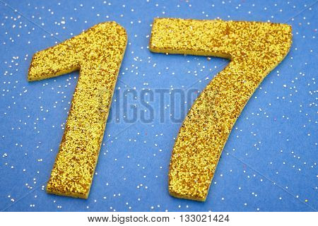 Number seventeen yellow color over a blue background. Anniversary. Horizontal