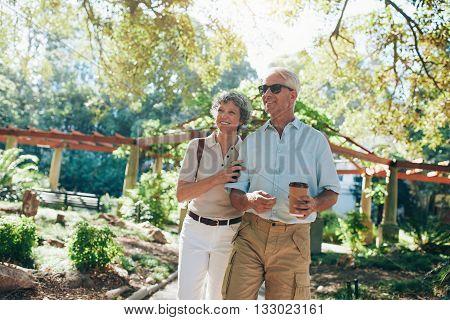 Affectionate Senior Couple Enjoying A Walk In The Park