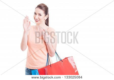Lady Carrying Shopping Bags Swearing Or Promising With Fingers Crossed