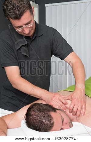 Sports Massage Therapist At Work